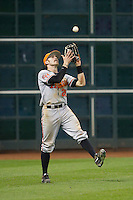 Sam Houston State Bearkats left fielder Luke Plucheck #26 catches a fly bal for the final out in the game against the Texas Christian Horned Frogs at Minute Maid Park on February 28, 2014 in Houston, Texas.  The Bearkats defeated the Horned Frogs 9-4.  (Brian Westerholt/Four Seam Images)