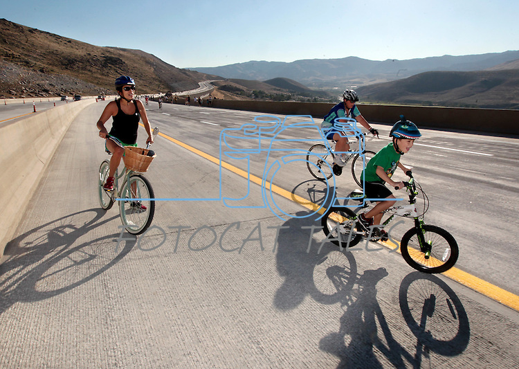 """Melanie Lazear, left, and her son Grayson, 6, ride in the I-580 """"Rush to Washoe"""" event before the new 8.5 mile freeway between Reno and Carson City opens to traffic. The event, held Saturday, July 28, 2012, gave residents a chance to enjoy the views on what is being called the most scenic highway in Nevada. .Photo by Cathleen Allison"""