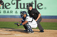 Wilmington Blue Rocks catcher MJ Melendez (7) sets a target as home plate umpire Steven Jaschinski looks on during the game against the Fayetteville Woodpeckers at Frawley Stadium on June 6, 2019 in Wilmington, Delaware. The Woodpeckers defeated the Blue Rocks 8-1. (Brian Westerholt/Four Seam Images)