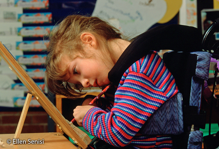 MR/ Schenectady, New York.Zoller Public School-Inclusion Class/ Grade 1.Girl (6, cerebral palsy, mainstreamed) does independent class work on specially designed adaptive surface..MR:Her4      FC#:21600-00115.scan from slide.© Ellen B. Senisi