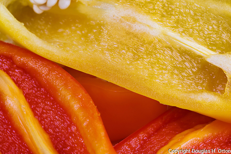 Sweet Peppers, species Capsicum annuum, sliced and stacked in close up image.  Ready for use.