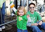 Kids anxiously look on as the annual St. Patrick's Day Parade proceeds up the streets of Manhattan in New York City on March 17, 2011.