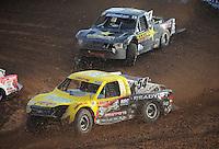Dec. 11, 2011; Chandler, AZ, USA;  LOORRS pro 2 driver Rob Naughton leads Rob MacCachren during the Lucas Oil Challenge Cup at Firebird International Raceway. Mandatory Credit: Mark J. Rebilas-