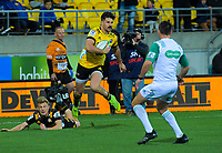 Hurricanes Kobus van Wyk scores after beating Chiefs Damian McKenzie in-goal during the Super Rugby Aotearoa match between the Hurricanes and Chiefs at Sky Stadium in Wellington, New Zealand on Saturday, 8 August 2020. Photo: Dave Lintott / lintottphoto.co.nz