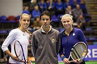 19-12-10, Tennis, Rotterdam, Reaal Tennis Masters 2010,   Umpire geflankeerd door Aranxta Rus en Michaella Krajicek(R)