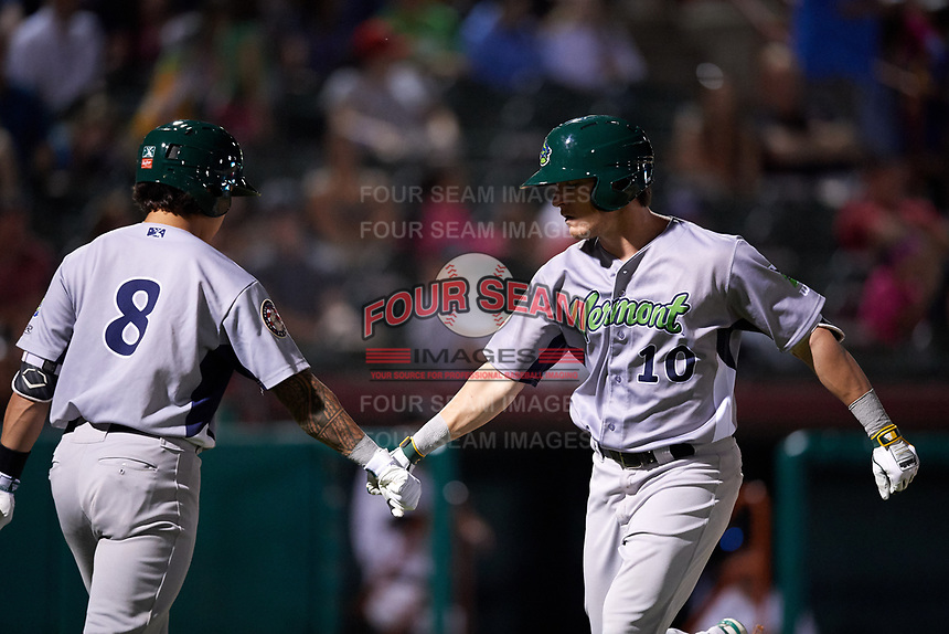 Vermont Lake Monsters designated hitter Anthony Churlin (10) is congratulated by Lana Akau (8) after hitting a home run in the top of the ninth inning during a game against the Tri-City ValleyCats on June 16, 2018 at Joseph L. Bruno Stadium in Troy, New York.  Vermont defeated Tri-City 6-2.  (Mike Janes/Four Seam Images)