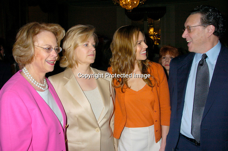 Ann Moore, Martha Nelson, Hilary Swank and Norman Pearlstine ..at the New York Women in Communications 2004 Matrix ..Awards Luncheon on April 19, 2004 at the Waldorf Astoria ..Hotel. Photo by Robin Platzer, Twin Images