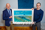 "John Fitzgerald of Lispole receives one of John Hurley's paintings ""Skellig Summer"" that he won in the Kerry's Eye competition from Brendan Kennelly of Kerrys eye on Tuesday. L to r: Brendan Kennelly and John Fitzgerald"