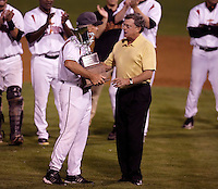 Tom Trebelhorn, manager of the Salem-Keizer Volcanoes, is presented with the league championship trophy by Northwest League president Bob Richmond after the final game of the Northwest League championship game against the Tri-City Dust Devils at Volcanoes Stadium, Keizer, Oregon - 9/10/2009. The Volcanoes won the deciding game, 2-1, in 13 innings to win the series, 3 games to 1..Photo by:  Bill Mitchell/Four Seam Images..