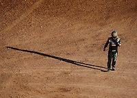 Apr 18, 2010; Surprise, AZ USA; LOORRS pro 2 unlimited driver Jeremy McGrath walks away from his truck after crashing during round four at Speedworld Off Road Park. Mandatory Credit: Mark J. Rebilas-US PRESSWIRE.