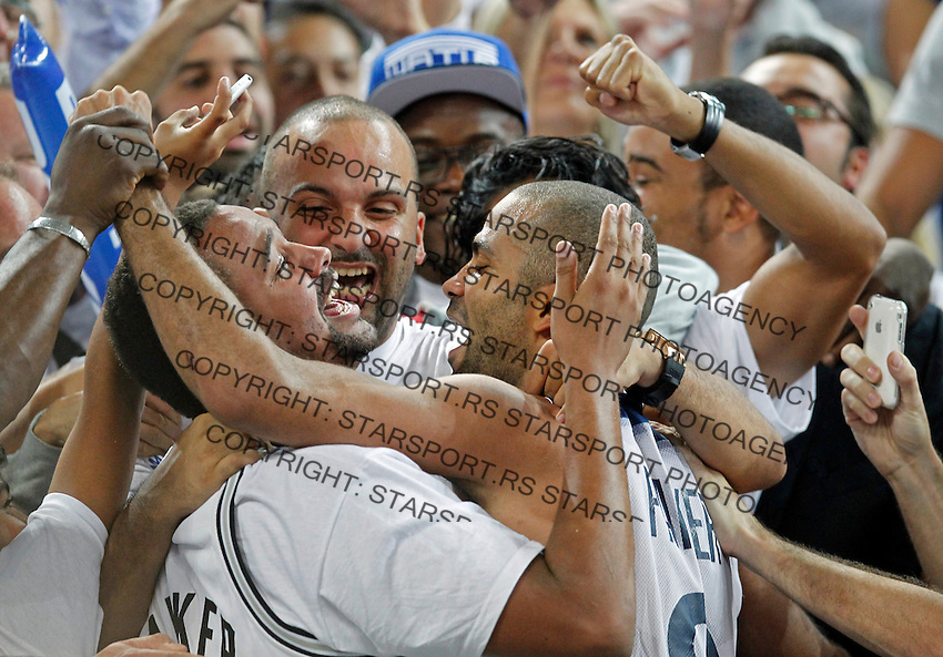"France`s Tony Parker celebrate with French national basketball team suppoters after European basketball championship ""Eurobasket 2013""  final game between France and Lithuania in Stozice Arena in Ljubljana, Slovenia, on September 22. 2013. (credit: Pedja Milosavljevic  / thepedja@gmail.com / +381641260959)"