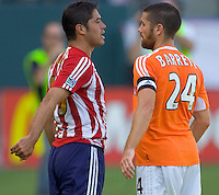 Houston Dynamo Def & Captain Wade Barrett argues with CD Chivas Fwd Juan Pablo Garcia during a MLS playoff match. Chivas beat Houston 2-1 at The Home Depot Center in Carson, California, Sunday Oct. 22, 2006.