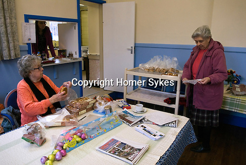 Mary Mallatratt Hot Cross Bun Legacy. Good Friday annually Mansfield Nottinghamshire. Mrs Audrey Morgan  and  Mrs Ann Blinch bag up 48 Hot Cross Buns for distribution to children and local in the nearby shopping centre