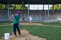 Kids practice hitting  the softball on Sharpe Field, a softball diamond on the grounds of the Chautauqua Institution. Photo Brendan Bannon. June 26, 2014. Chautauqua, NY