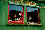 Oregon Coast Scenic Railway passenger car with manequins for passengers sits on inoperative siding near the railway depot.  Garibaldi, Oregon on the northern Oregon Coast.