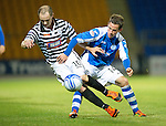 St Johnstone v Queens Park....25.09.12      Scottish Communities League Cup 3rd Round.Kevin Moon battles with Jamie Longworth.Picture by Graeme Hart..Copyright Perthshire Picture Agency.Tel: 01738 623350  Mobile: 07990 594431