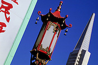 The Transamerica Pyramid building and a chinese reed lamp in Chinatown, San Francisco California, USA. The close up is angled  30 degrees foto, reise, photograph, image, images, photo,<br />