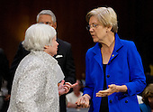 """Janet L. Yellen, Chair, Board of Governors of the Federal Reserve System, left, and United States Senator Elizabeth Warren (Democrat of Massachusetts), right, share some thoughts following Yellen's testimony before the U.S. Senate Committee on Banking, Housing and Urban Affairs on """"The Semiannual Monetary Policy Report to the Congress."""" on Capitol Hill in Washington, D.C. on Tuesday, July 15, 2014.<br /> Credit: Ron Sachs / CNP"""