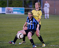 20140502 - VARSENARE , BELGIUM : Brugge's Lore Dezeure pictured with Lierse's Evelien Stoffels in her back during the soccer match between the women teams of Club Brugge Vrouwen  and WD Lierse SK  , on the 26th matchday of the BeNeleague competition on Friday 2 May 2014 in Varsenare .  PHOTO DAVID CATRY