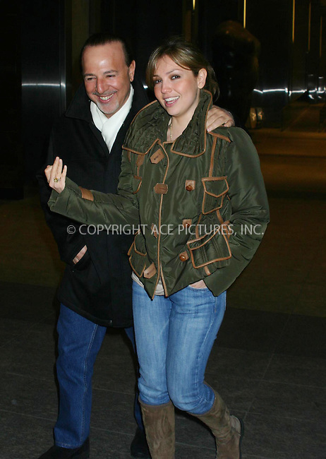 tommy mattola and thalia soto fool around for the camera while out on the town in nyc.   bocklet