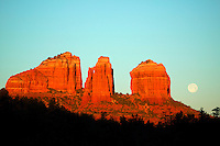 Full moon and sunrise light on Cathedral Rock, Sedona, Arizona.