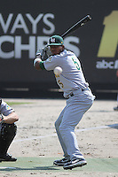 """Lynchburg Hillcats DH Edward Salcedo #5 """"standing in"""" during a bullpen session before a game against the Carolina Mudcats at Five County Stadium on April 26, 2012 in Zebulon, North Carolina. Carolina defeated Lynchburg by the score of 8-5. (Robert Gurganus/Four Seam Images)"""