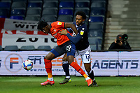 23rd February 2021; Kenilworth Road, Luton, Bedfordshire, England; English Football League Championship Football, Luton Town versus Millwall; Elijah Adebayo of Luton Town shields the ball from Mahlon Romeo of Millwall