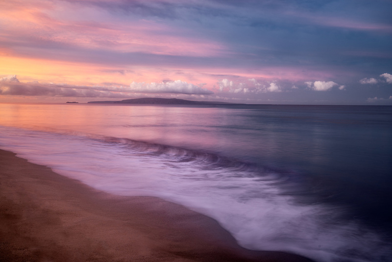 Shoreline and sunrise. with Kaho'olehu Island. Maui, Hawaii