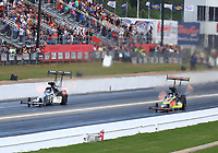 May 6, 2017; Commerce, GA, USA; NHRA top fuel driver Shawn Langdon (left) races alongside teammate Troy Coughlin Jr during qualifying for the Southern Nationals at Atlanta Dragway. Mandatory Credit: Mark J. Rebilas-USA TODAY Sports