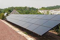 Large solar panels in open site to power farm greenhouses passively for solar energy