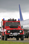 Land Rover Defender fire engine on the Dunsfold aerodrome, Surrey, UK. --- No releases available, but releases may not be necessary for certain uses. Automotive trademarks are the property of the trademark holder, authorization may be needed for some uses.