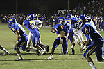 Quarterback pitches the ball back to his running back for an end around running play.