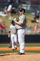 Birmingham Barons relief pitcher Tyler Barnette (44) rubs up the baseball during the game against the Tennessee Smokies at Regions Field on May 3, 2015 in Birmingham, Alabama.  The Smokies defeated the Barons 3-0.  (Brian Westerholt/Four Seam Images)