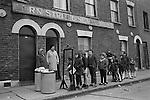 Farthing Bundles. Fern Street Settlement, east London. England 1971. Florrie Ally standing in the doorway.