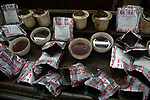 Tea packets and cup of teas for testing at the tea testing room of J. Thomas ltd. company in Kolkata, West Bengal,  India, Arindam Mukherjee