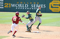 Daniel Patzlaff (26) of the Oregon Ducks throws to first base after forcing out Angelo La Bruna (13) of the Southern California Trojans at second base during a game at Dedeaux Field on April 18, 2015 in Los Angeles, California. Oregon defeated Southern California, 15-4. (Larry Goren/Four Seam Images)