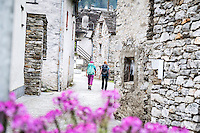 The Via Alta Verzasca is a five day ridge traverse hike above the Valle Verzasca in the Ticino region of Switzerland. Hikers arriving to the old village of Sonogno at the end of the route.
