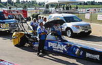 Jul, 8, 2011; Joliet, IL, USA: NHRA top fuel dragster crew members for driver T.J. Zizzo during qualifying for the Route 66 Nationals at Route 66 Raceway. Mandatory Credit: Mark J. Rebilas-