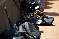 Baseball equipment lines the wall of the dugout during the East Coast Pro Showcase at the Hoover Met Complex on August 3, 2020 in Hoover, AL. (Brian Westerholt/Four Seam Images)