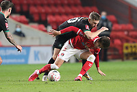 Panutche Camara  of Plymouth Argyle fouls Dylan Levitt of Charlton Athletic during Charlton Athletic vs Plymouth Argyle, Emirates FA Cup Football at The Valley on 7th November 2020