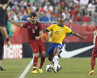 Brazil defender Maicon (15) disrupts Portugal forward Nelson Oliveira (9) effort. In an international friendly, Brazil (yellow/blue) defeated Portugal (red), 3-1, at Gillette Stadium on September 10, 2013.