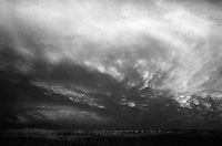 Storm clouds in infrared.<br /> <br /> Nikon F3HP, 24mm lens, Kodak High Speed Infrared film, red filter
