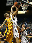 Nevada's Robyn Missa drives past Northwest Christian's Austin Kuemper during a college basketball game in Reno, Nev., on Sunday, Dec. 28, 2014. Nevada won 81-67.<br /> Photo by Cathleen Allison