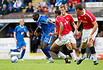 St Johnstone v Man Utd XI....31.07.10  Alan Main Testimonial.Cleveland Taylor breaks free from Zeke Fryers.Picture by Graeme Hart..Copyright Perthshire Picture Agency.Tel: 01738 623350  Mobile: 07990 594431