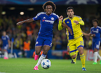 Goalscorer Willian of Chelsea holds off Avraham Rikan of M Tel Aviv during the UEFA Champions League match between Chelsea and Maccabi Tel Aviv at Stamford Bridge, London, England on 16 September 2015. Photo by Andy Rowland.