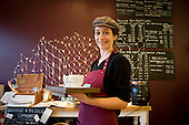 Clara, one of the three women who run Alimentari Italian delcatessen and coffee shop, Kilburn Lane, Queen's Park.