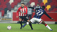 Saman Ghoddos of Brentford takes the ball past Middlesbrough's Marc Bola during Brentford vs Middlesbrough, Emirates FA Cup Football at the Brentford Community Stadium on 9th January 2021
