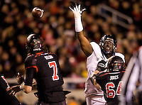 Deandre Coleman of California tries to block the ball from Utah quarterback Travis Wilson during the game at Rice-Eccles Stadium in Salt Lake City, Utah on October 27th, 2012.   Utah Utes defeated California, 49-27.