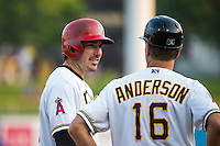 Matt Joyce (30) of the Salt Lake Bees stands at third base and talks to Manager Dave Anderson (16) during the game against the Iowa Cubs in Pacific Coast League action at Smith's Ballpark on August 20, 2015 in Salt Lake City, Utah. The Cubs defeated the Bees 13-2.  (Stephen Smith/Four Seam Images)