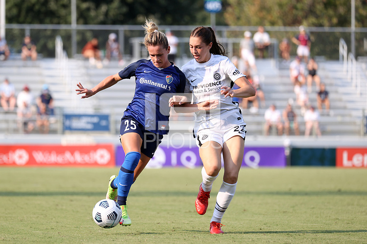 CARY, NC - SEPTEMBER 12: Meredith Speck #25 of the North Carolina Courage is defended by Morgan Weaver #22 of the Portland Thorns FC during a game between Portland Thorns FC and North Carolina Courage at Sahlen's Stadium at WakeMed Soccer Park on September 12, 2021 in Cary, North Carolina.